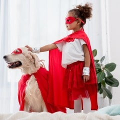 side-view-of-cute-little-african-american-kid-and-dog-standing-on-the-picture-id1067129388 (1)-min